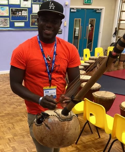 Sidiki Dembele tuning up with his N'goni African harp before the drumming sessions.