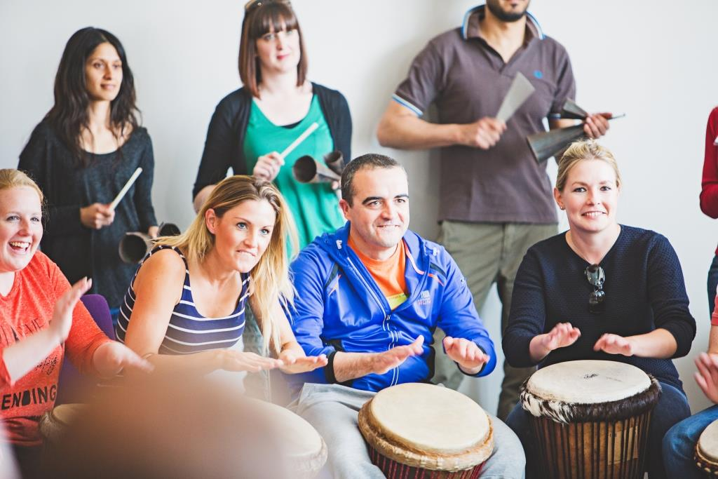 Smiley colleagues attending our African drumming team building session this month!