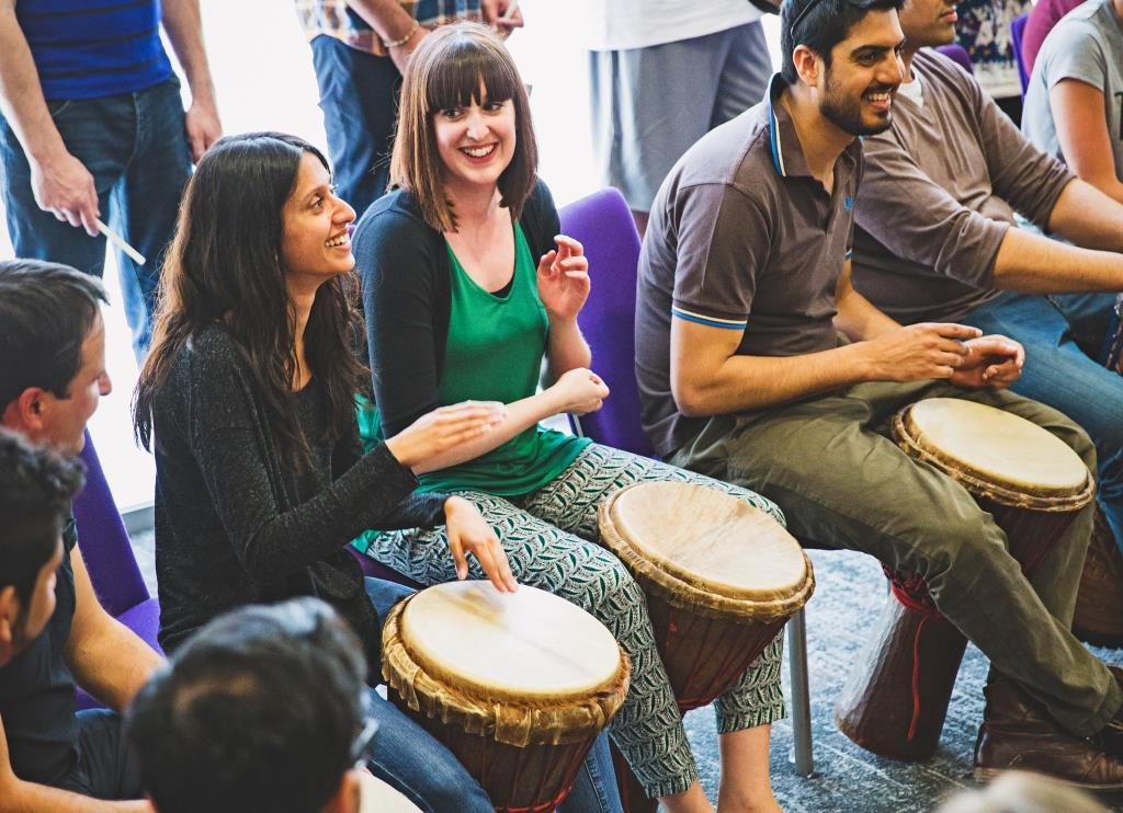 Tapping your foot to mark the pulse in African Drumming