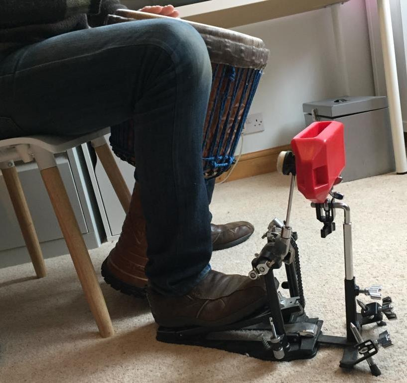 The device I currently use to mark the pulse with my foot when playing. I can't really recall what the device is called but it attaches to a drum pedal to create a sharp consistent clear sound - the clarity of which gets missed with ankle bells.