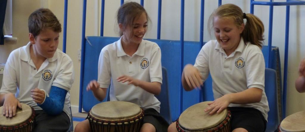 with African drumming the whole class succeeds together!