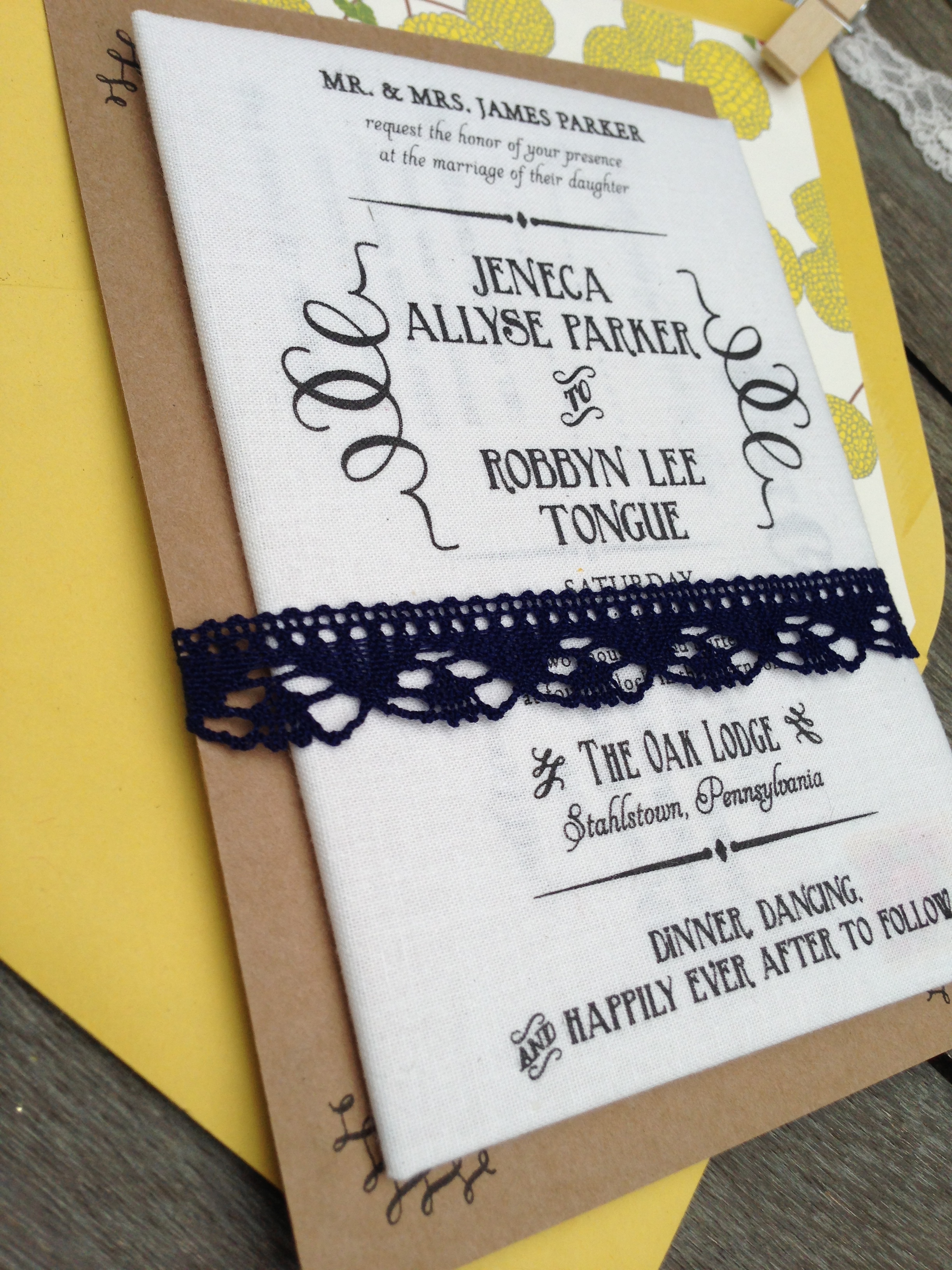 The fabric invitation was folded and wrapped around the other cards for wedding while a fun map provided the spine for the entire card pack.    We bound everything with a Chantilly lace wrap in navy blue.