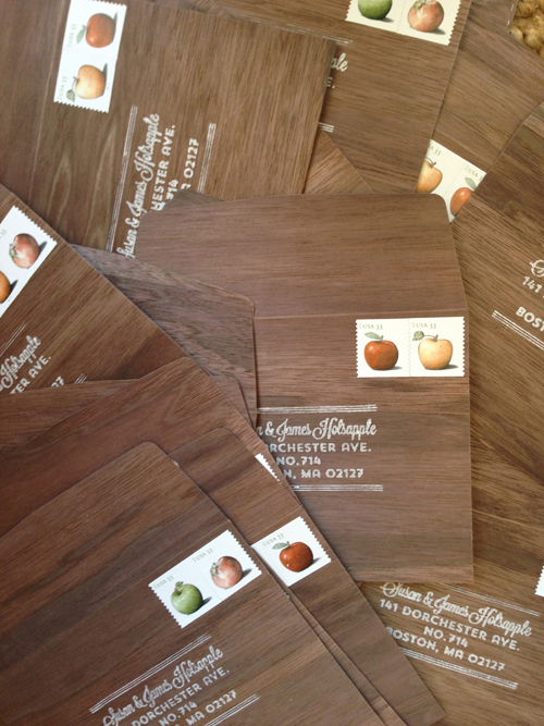 One element that tied together the pretty distant looks of the save the date and invitation were the walnut wood reply envelopes. Rubber stamped with return address in white and postage stamped with apples.