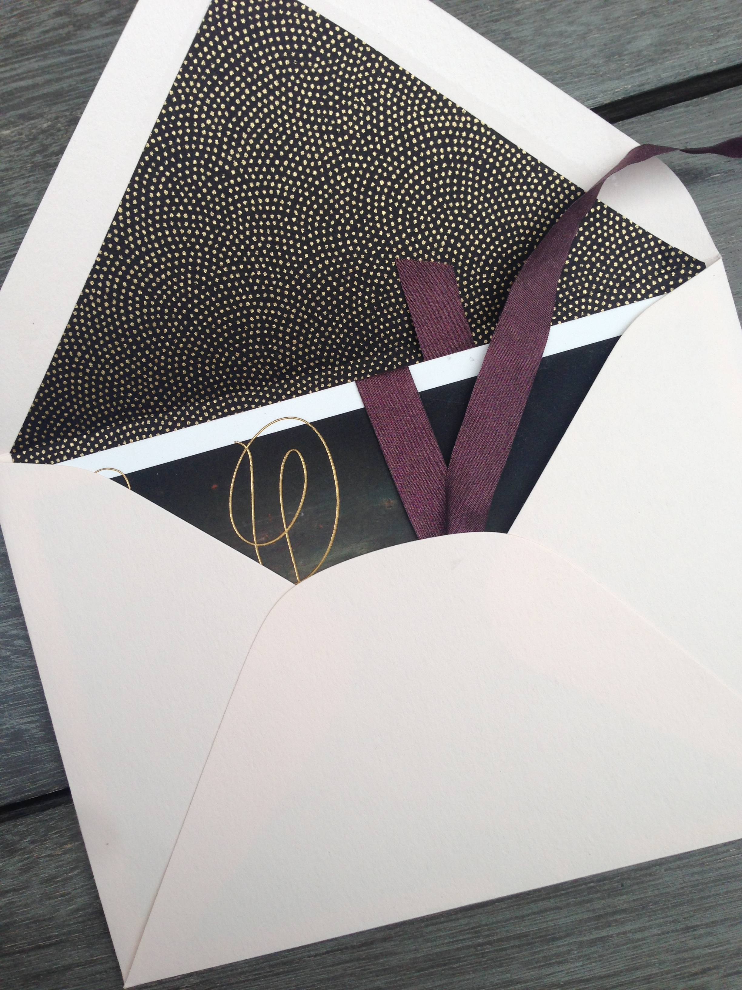 Katie desired that, while her wedding would take place in their barn, the invitation conveyed a sense of Saturday night elegance. Tones of deep purple and blush mixed with black and gold.