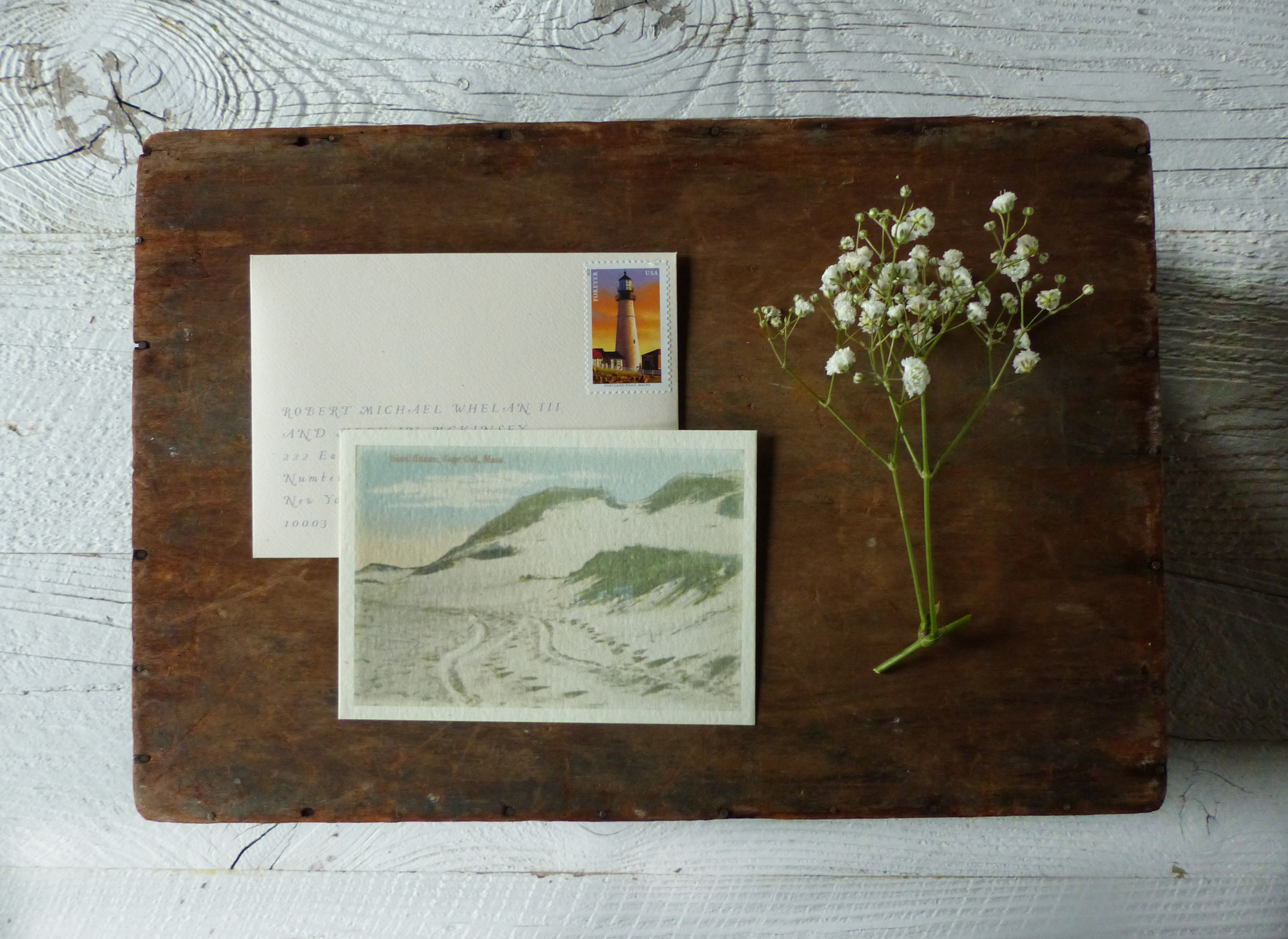 A vintage photo of the famous Cape Cod dunes was printed on the back of the reply card, with a perfectly pink sand reply envelope.