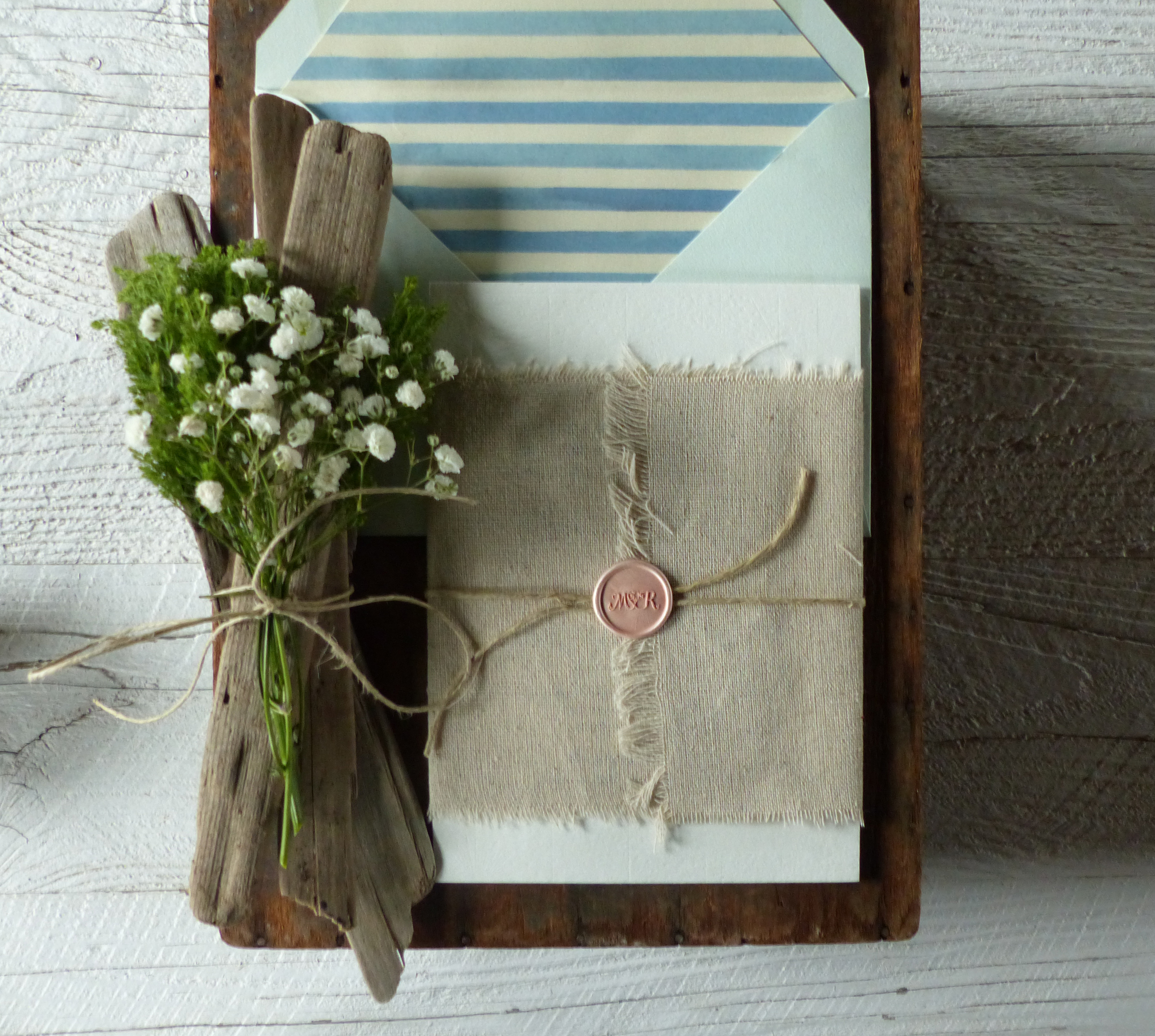 The invitation was wrapped with Belgian linen and sealed with a custom wax seal embossed with the couple's monogram.