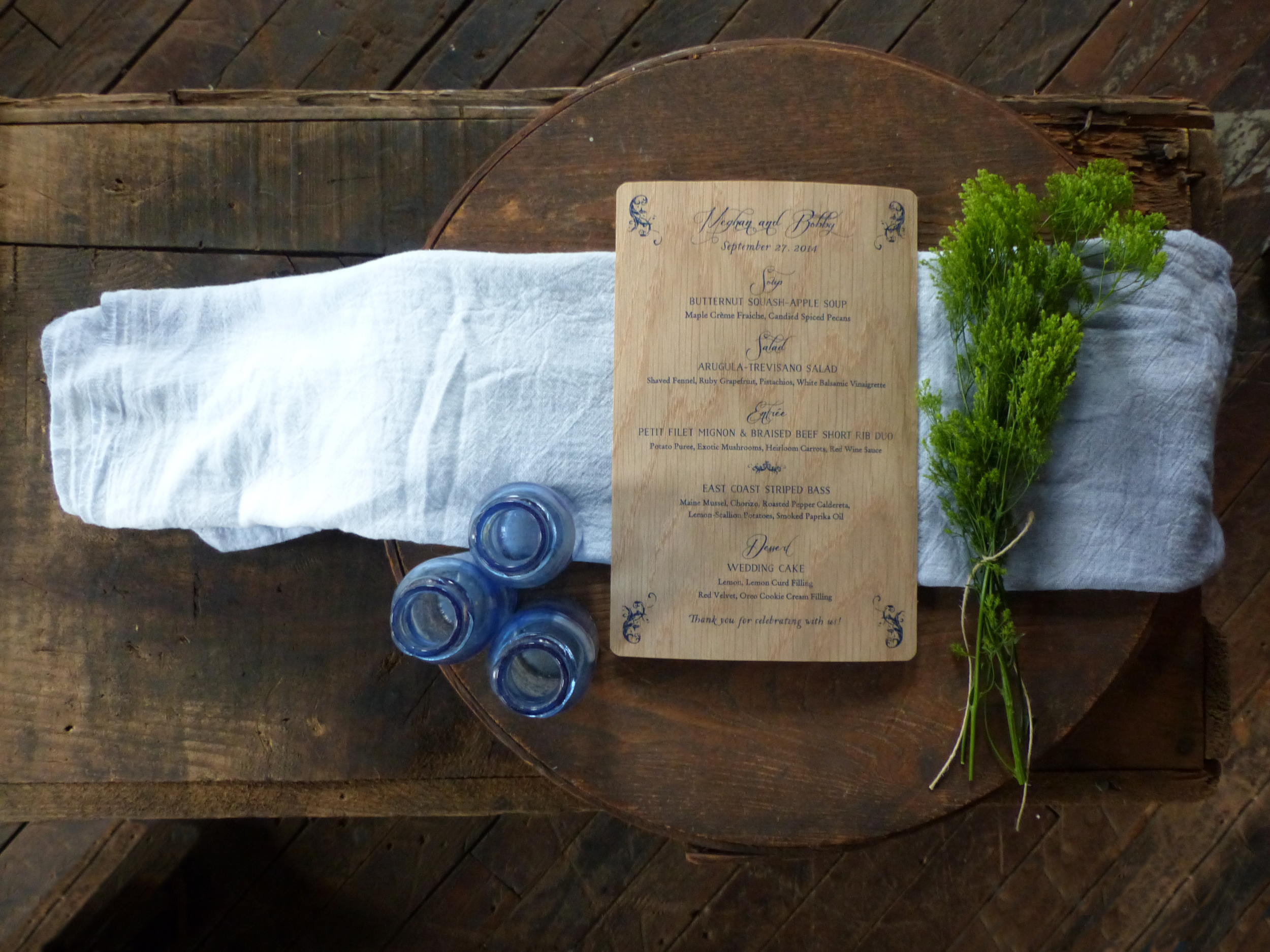"""Day Of Wedding"" pieces include a wood printed menu."