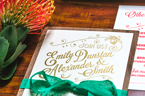 The invitation was printed with metallic gold and backed with walnut veneer. A bright green loose weave cotton ribbon held the other cards in place behind the main invitation.