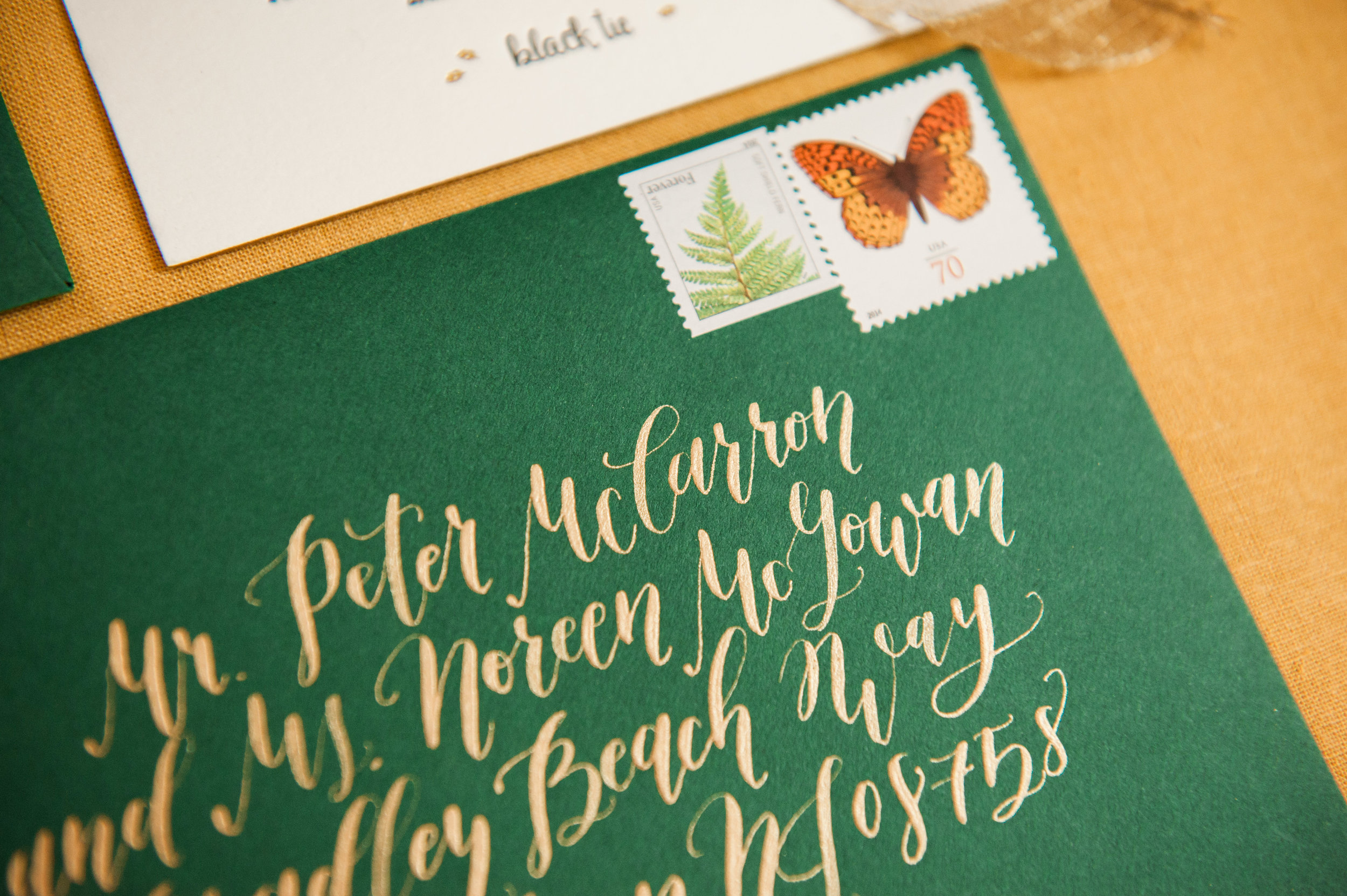 Kim at Manayunk Calligraphy added the perfect finishing touch of gold on the forest green envelope.
