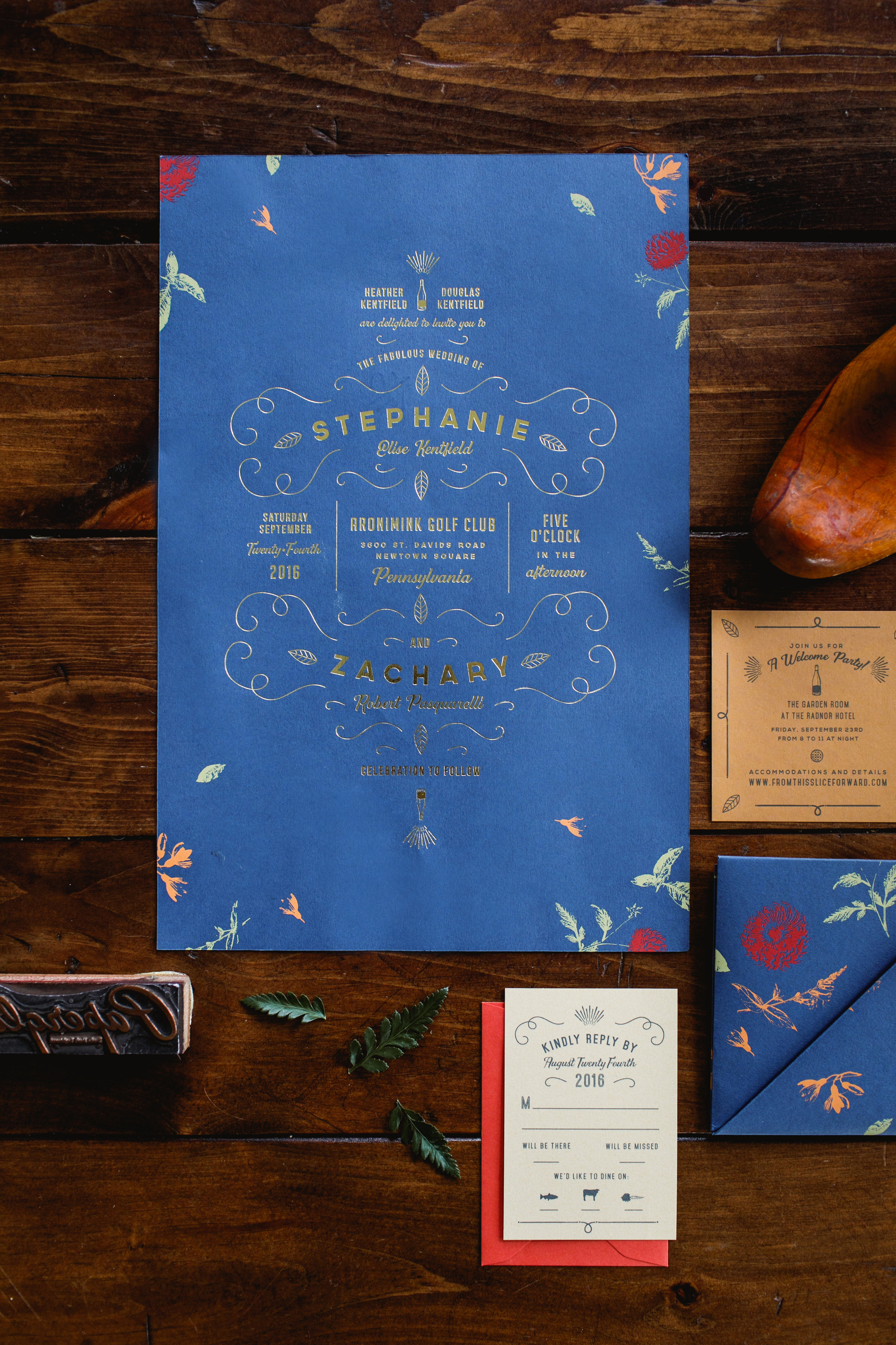 Oversized royal blue gold foil invitation with screen printed flowers for a fall wedding