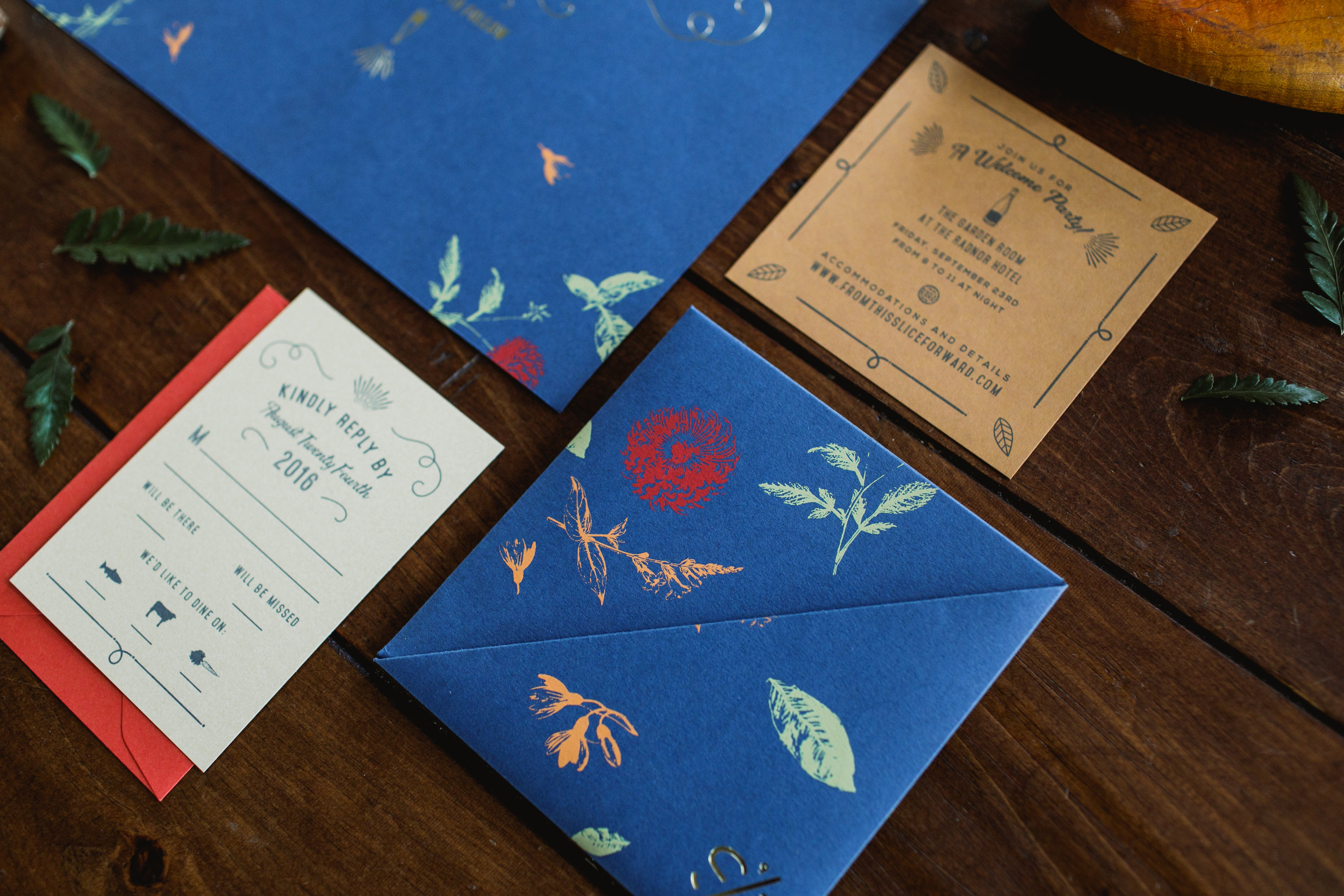 Royal blue invitation suite with screen printed origami folded card