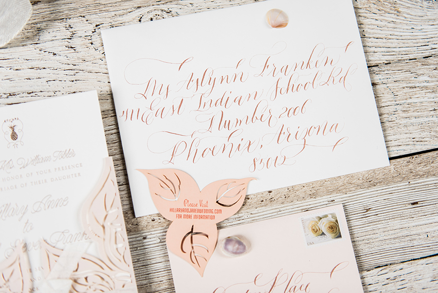 The envelopes were calligraphed in rose gold to match the gold foil of the text on the invitation cards.