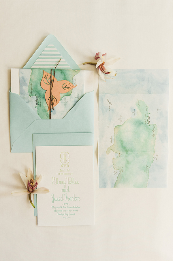 In contrast to the invitation, the save the date, was a bit more fun and colorful. Playing more off of the Caribbean destination.   We printed a custom watercolored map of Jamaica on a gossamer textured paper to wrap around the save the date card.