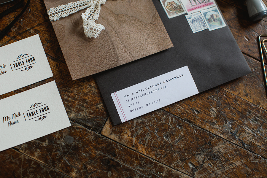 We used a faded black envelope with a vintage typewriter label to complete the antiqued theme of the suite.