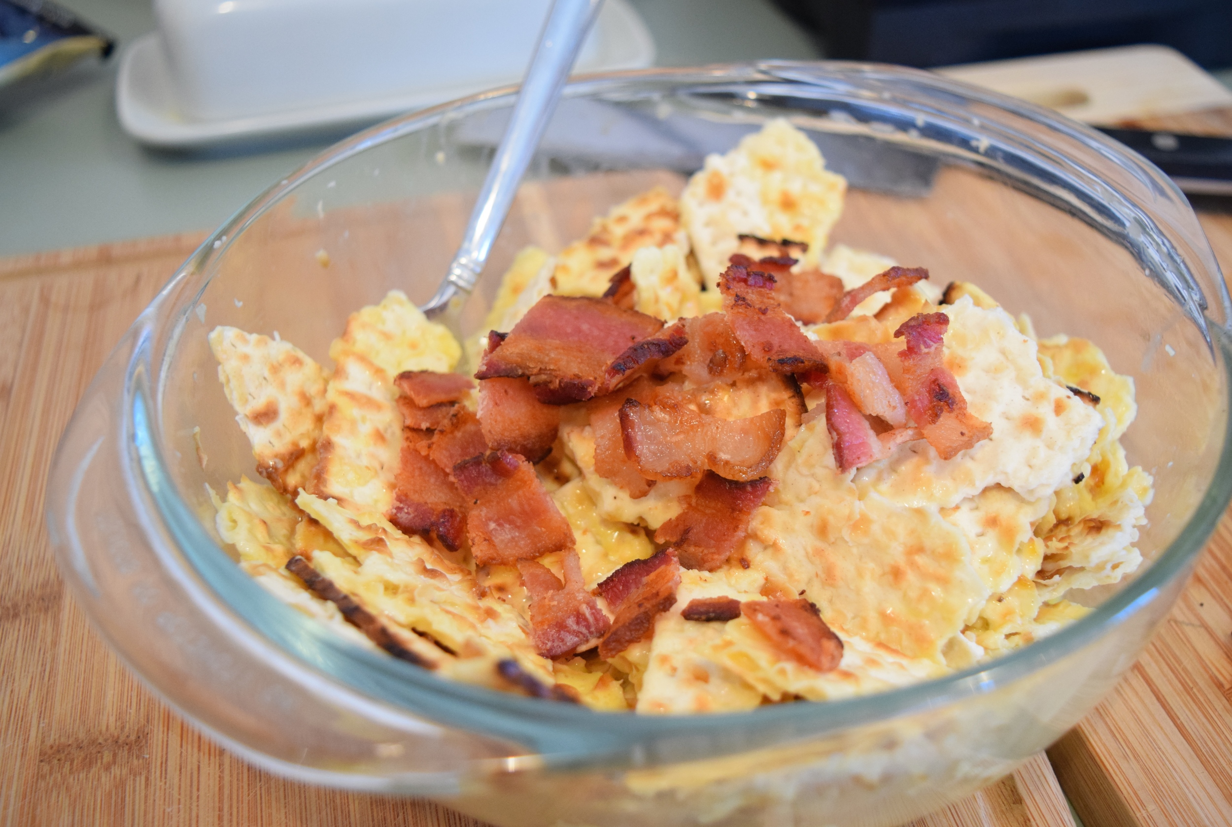 Toss the damp matza with egg and cooked and cooled bacon pieces.