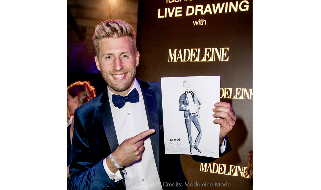 Maximilian Arland with a drawing by Virginia Romo at the Tribute to Bambi 2018