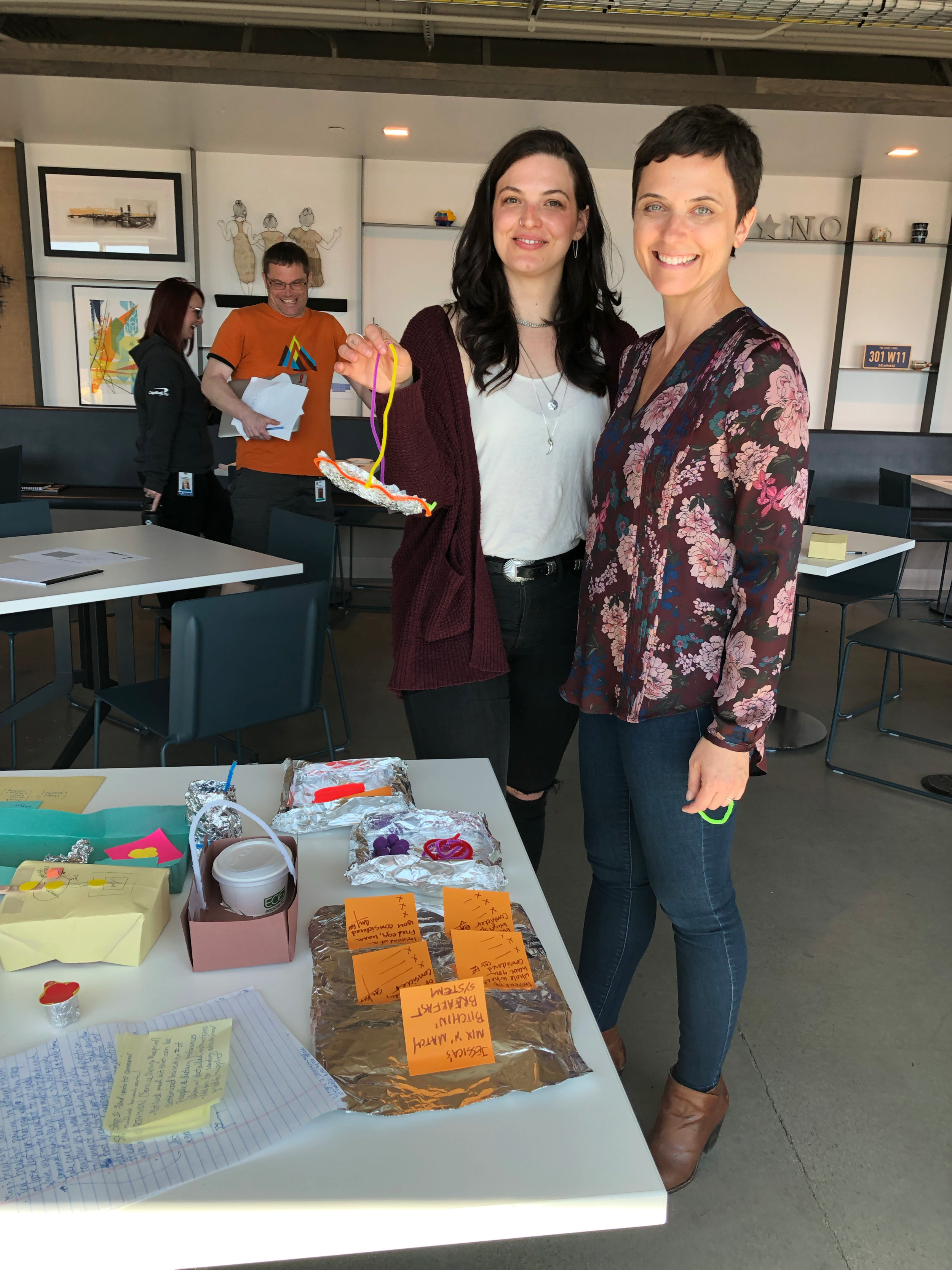 Co-collaborator Maria Doherty, and I looking at prototypes from the workshop - Thanks to Maria's product expertise, we were able to facilitate a Design Thinking workshop that was relevant to Capital One internal Design, Product, Tech and Content teams.