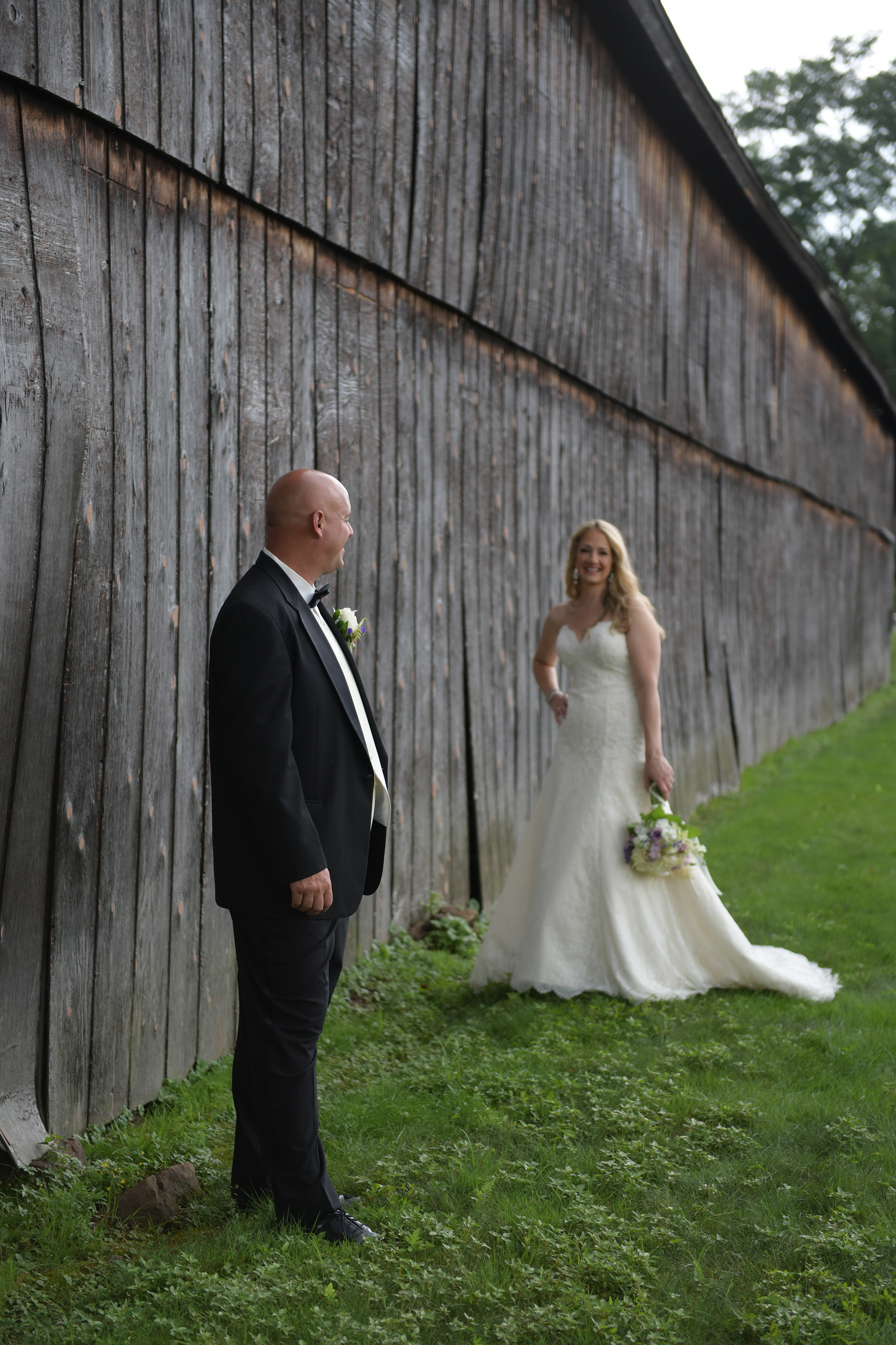 Bride and Groom posing for wedding pictures at Maneeley's of South Windsor. - Great old Barn