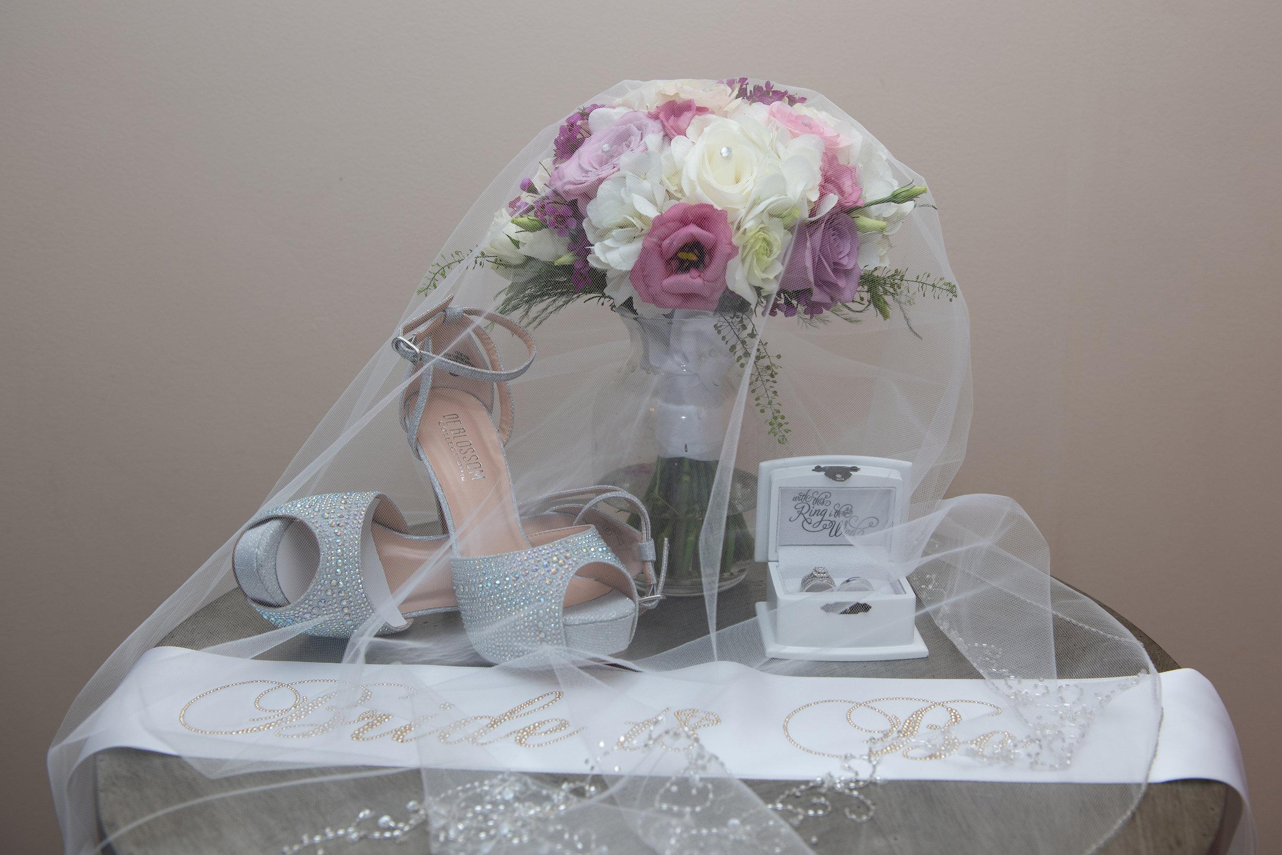 WICKHAM PARK WEDDING WEDDING VEIL COVERING BRIDE BOUQUET, WEDDING RINGS AND WEDDING SHOES