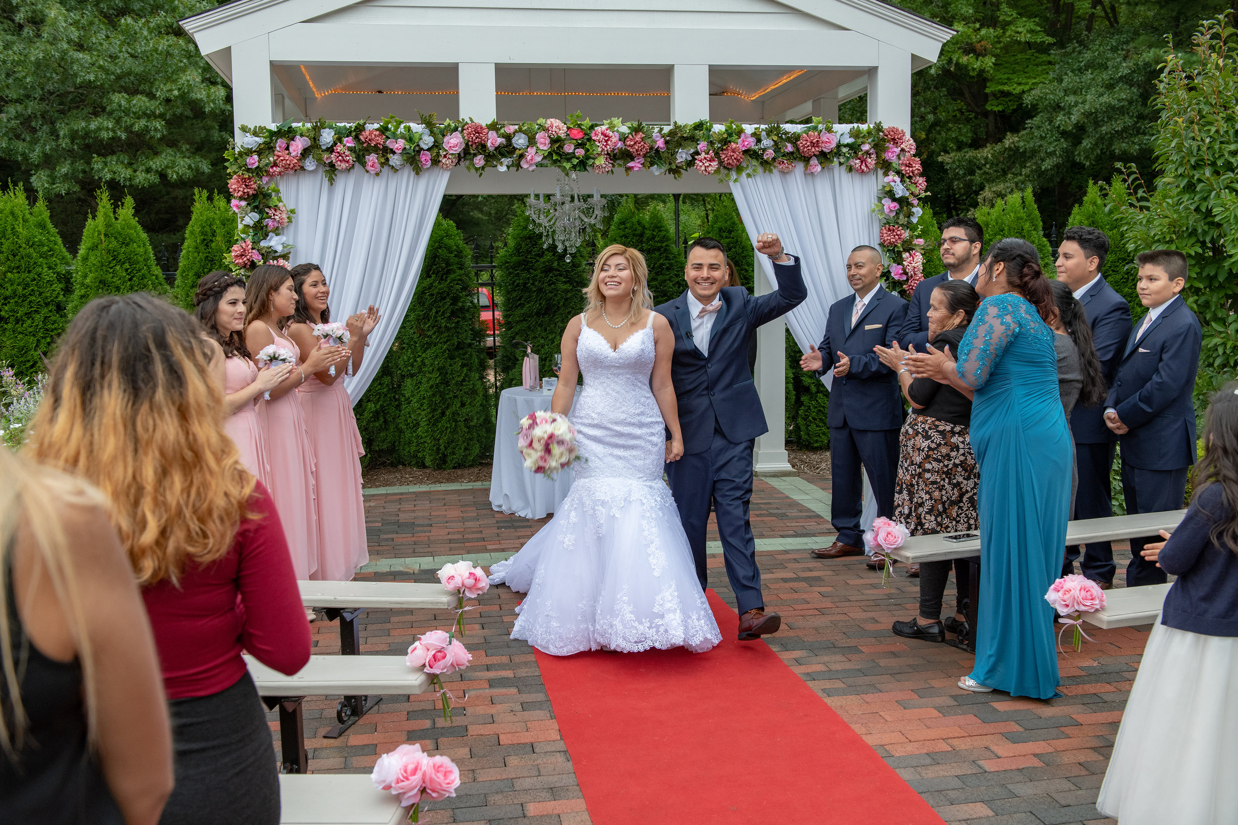THE WEDDING CEREMONY AT WICKHAM PARK IS OVER THE BRIDE AND GROOM EXIT THE CEREMONY.jpg