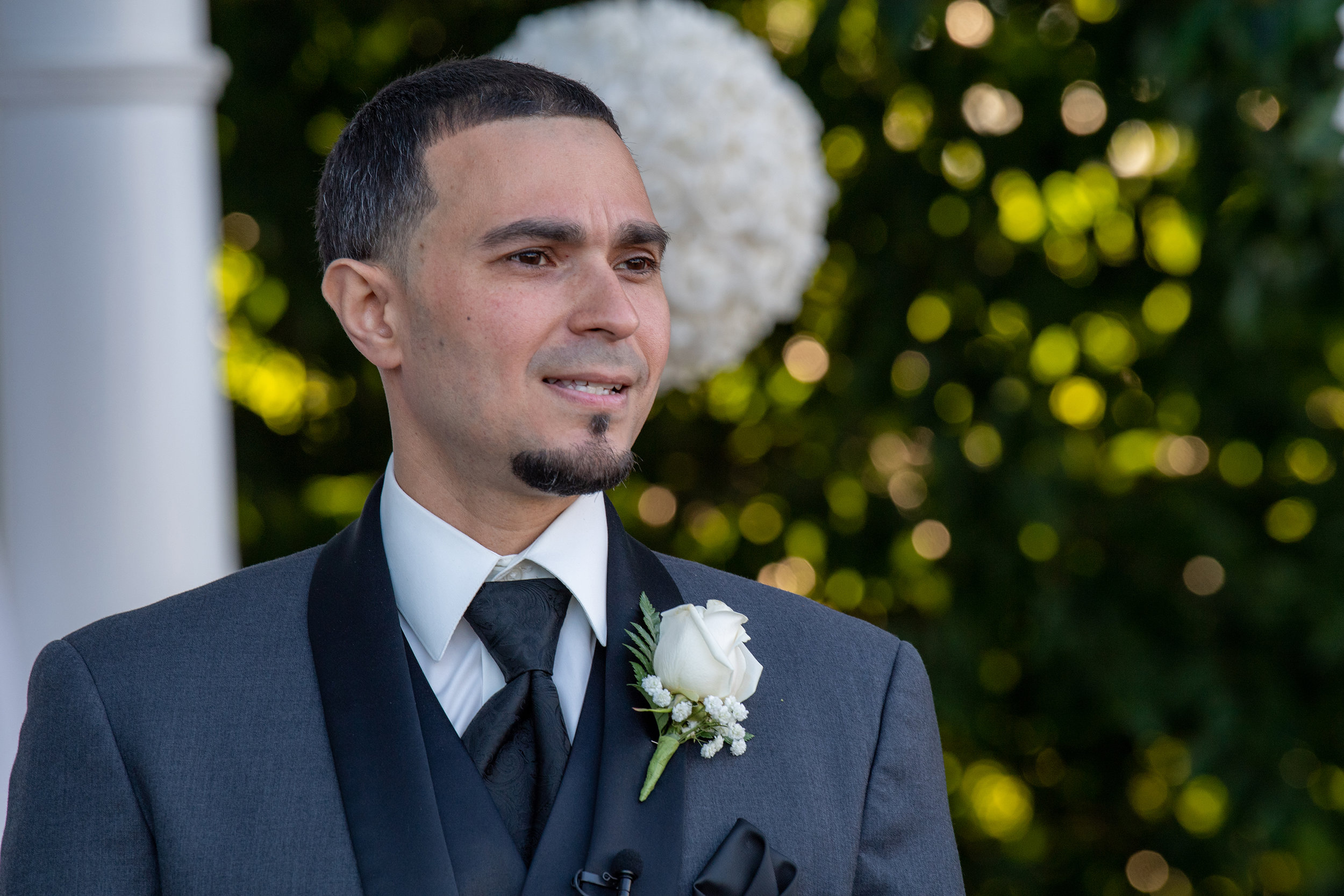 GROOM HOLDING BACK TEARS AS HIS BRIDE WALKS UP THE AISLE.jpg