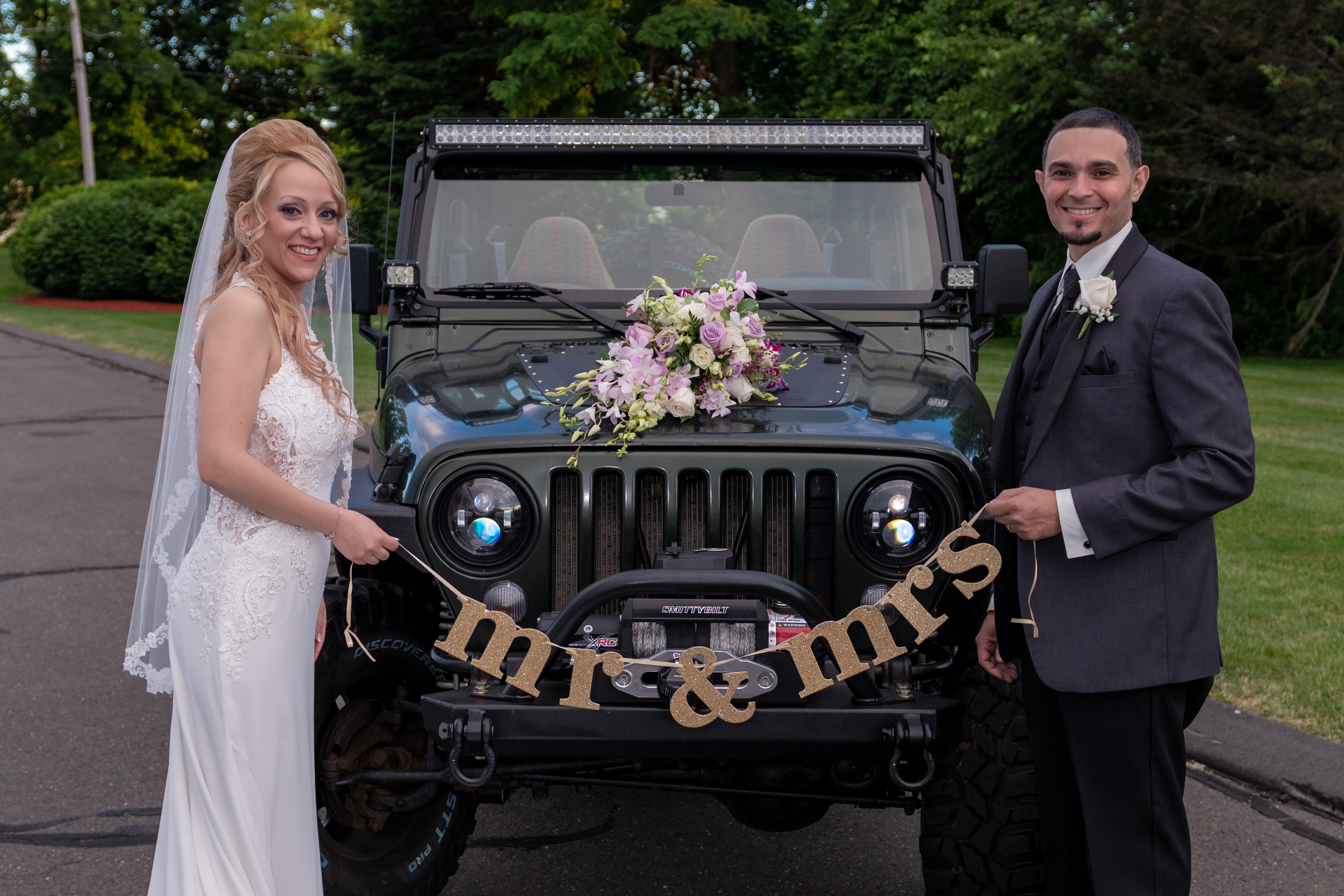 MR AND MRS IN FRONT OF JEEP.jpg