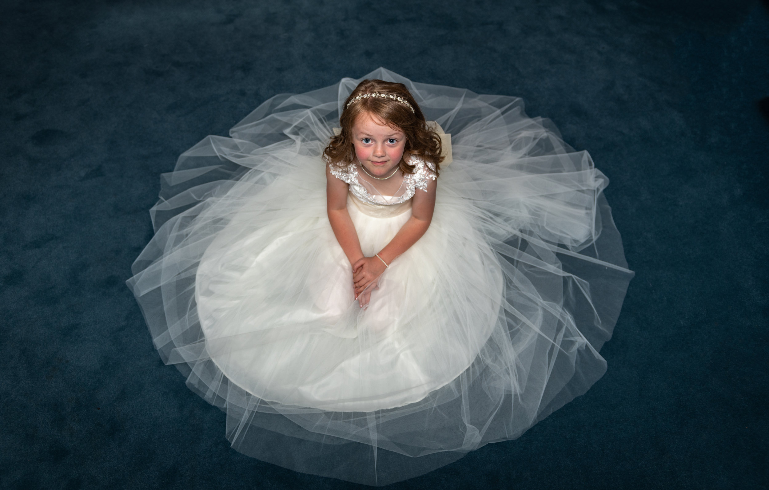 The adorable Flower Girl Amelia patiently waiting for everyone to finish dressing.