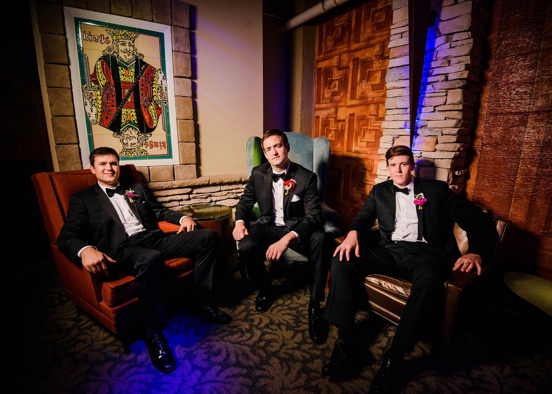 Dapper groomsmen in the underground lounge a.k.a. Speakeasy.