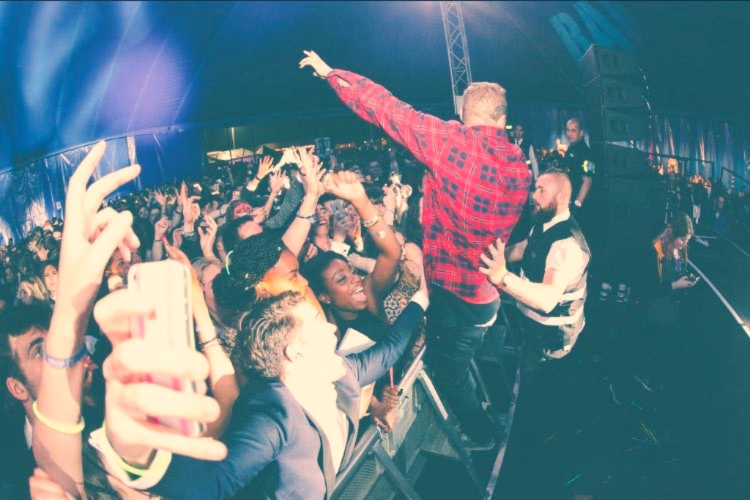 One of our   previous students  , seen here backing up UK Hip-hop Artist  Professor Green
