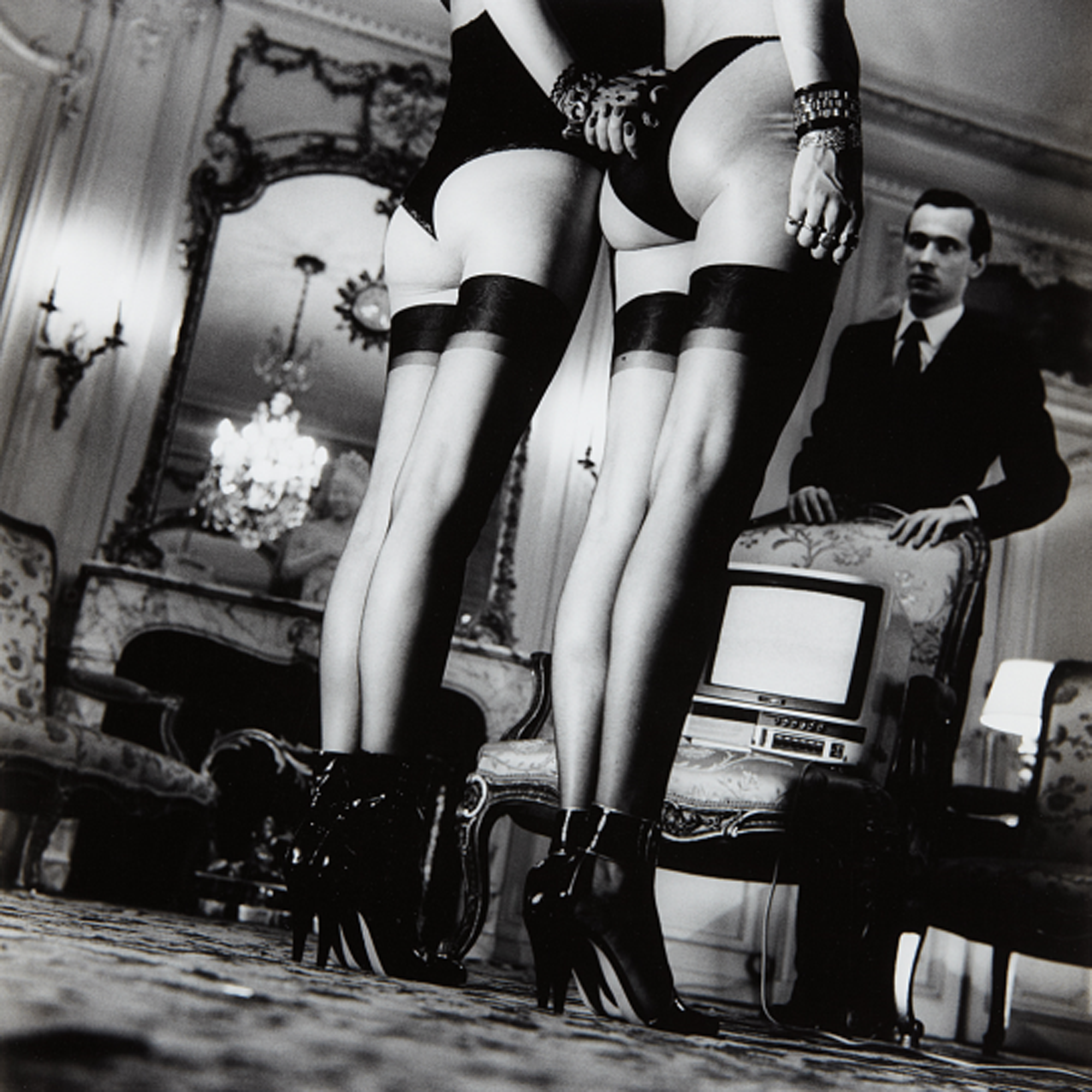 HELMUT NEWTON Two pairs of legs in black stockings, Paris, 1979 Gelatin silver print from Private Property Suite III, printed 1984.png