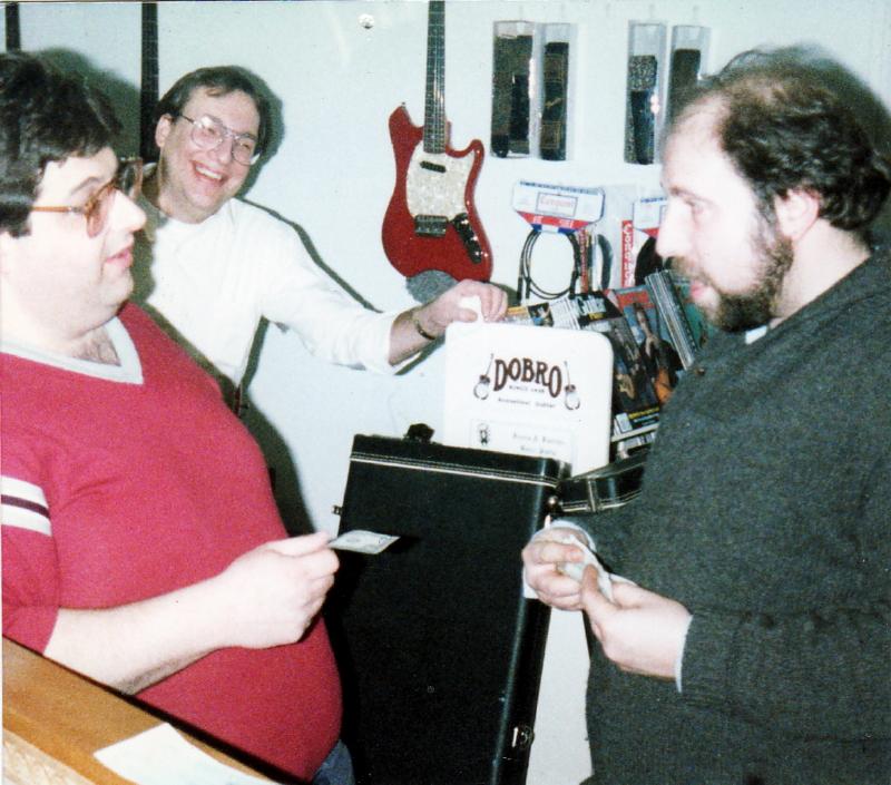 Retrofret owner, Steven Uhrik right, making the first sale in 1983.