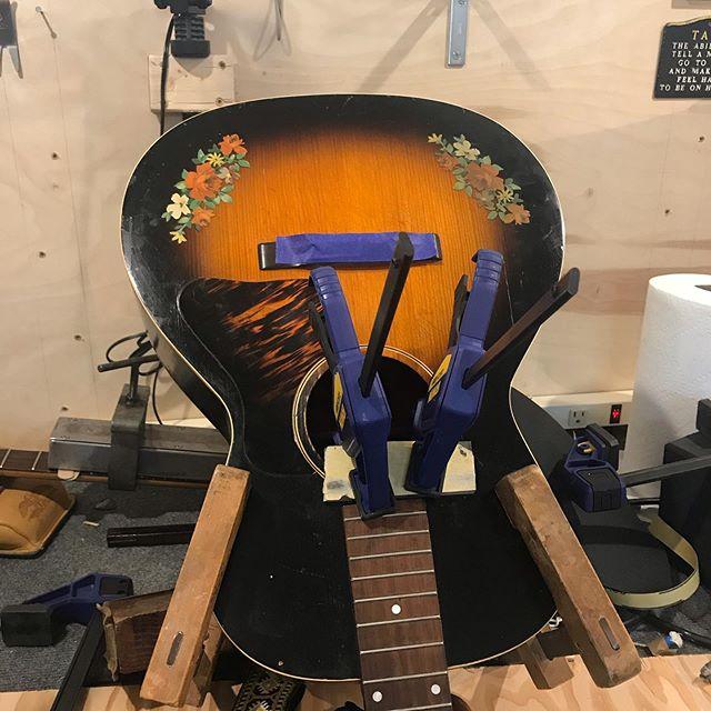Summer is for flowers and headstands.  #lutherie#guitarrepair#repair#woodworking#guitarsofinstagram#luthier#oldworld#vintage#relic#restoration#guitarporn#acousticcguitar#gibsonguitar#glue#outsidethebox#gibson#antique#summer#roses