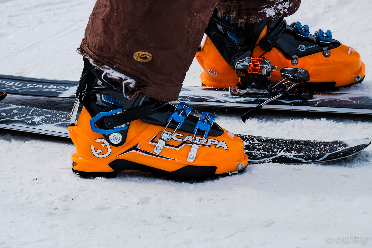 Orange ski boots and skis on snow at Orford QC olney photographe sherbrooke