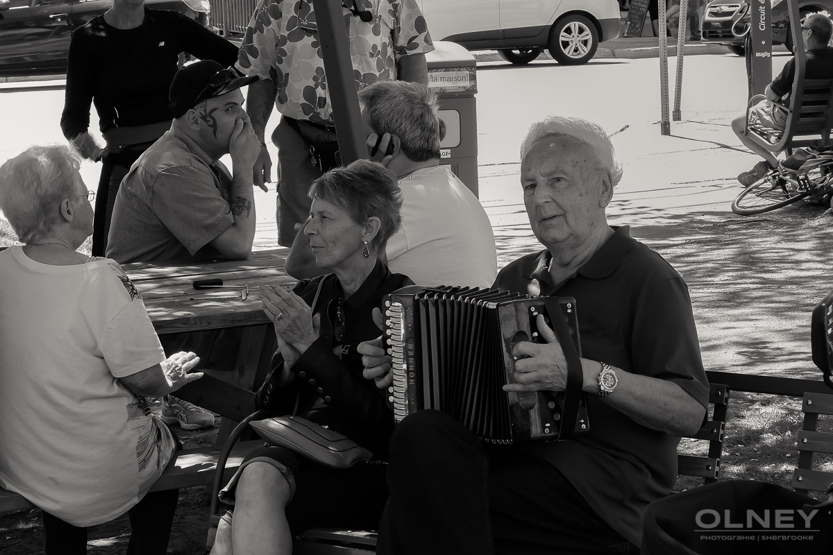 Public entertainer with accordion in Magog QC street photography olney photographe sherbrooke
