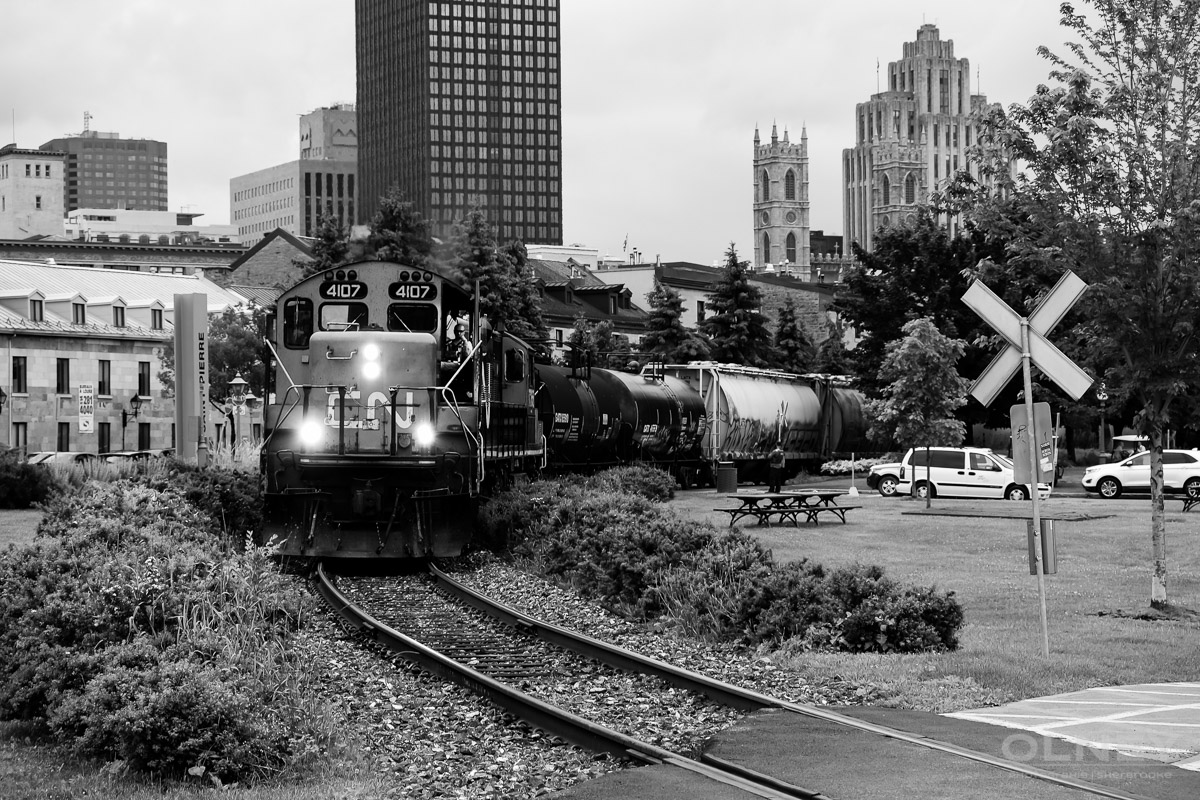 OLNEY-Train crossing Old Port Promenade in Montreal QC street photography olney photographe sherbrooke