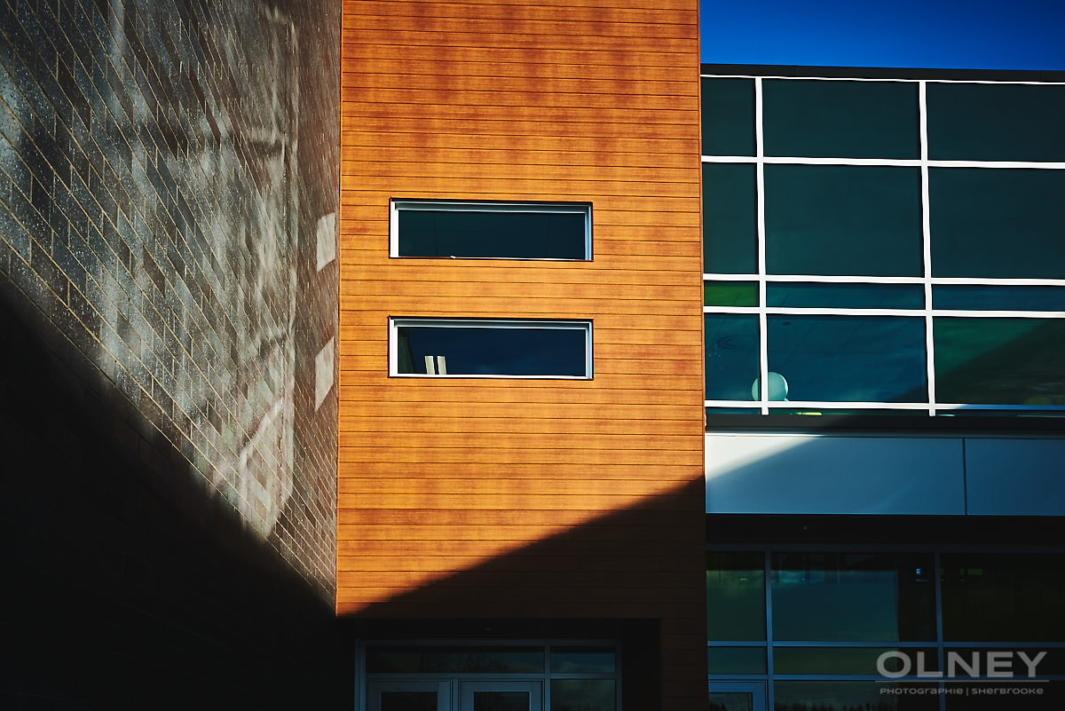siding glass and stone on new school construction