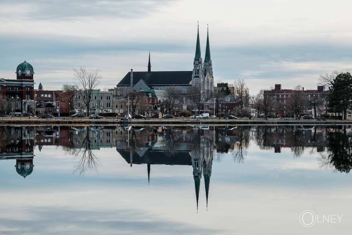 church reflecting in bay saint-francois