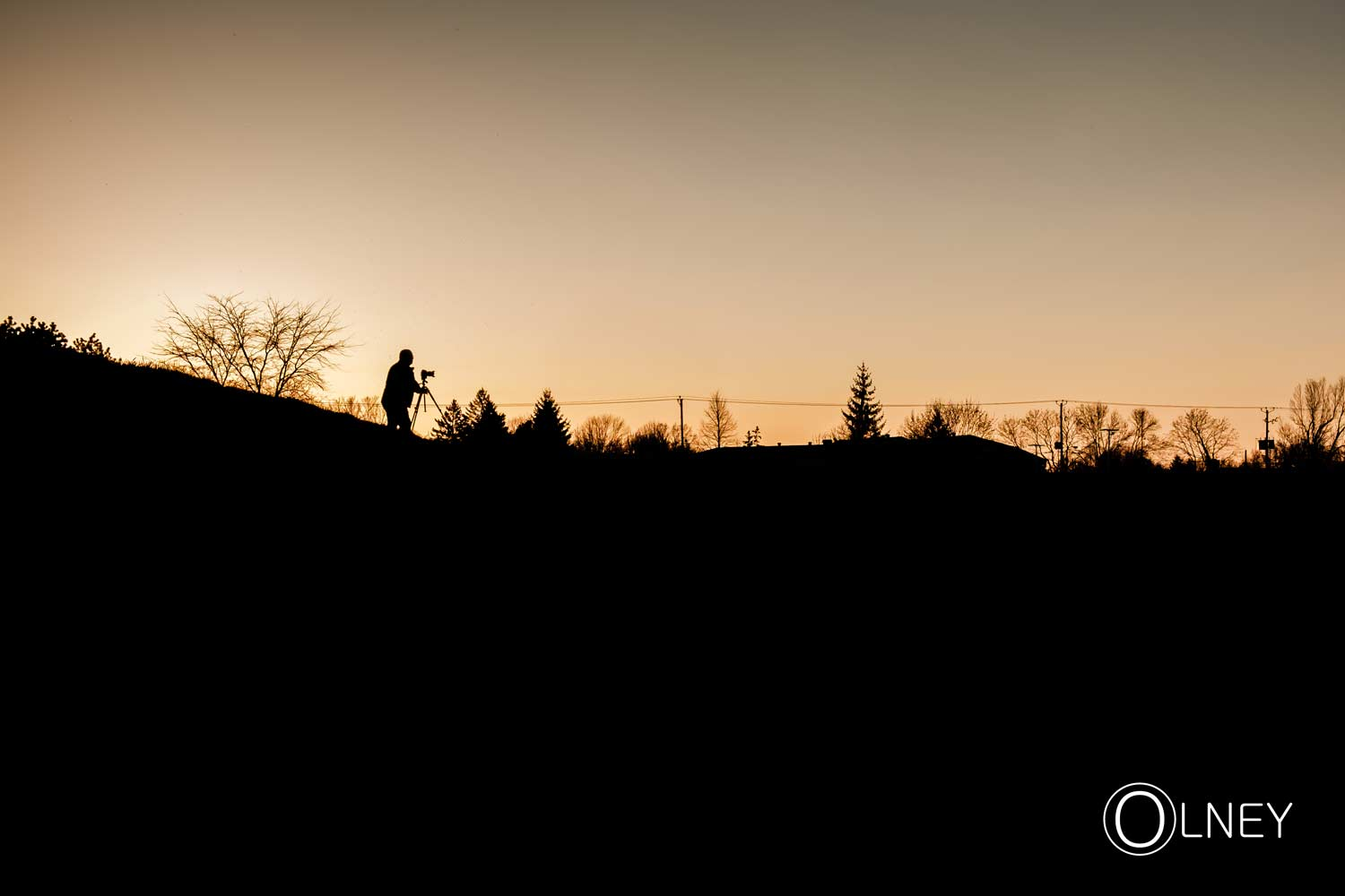 photgrapher silhouette against yellow sky
