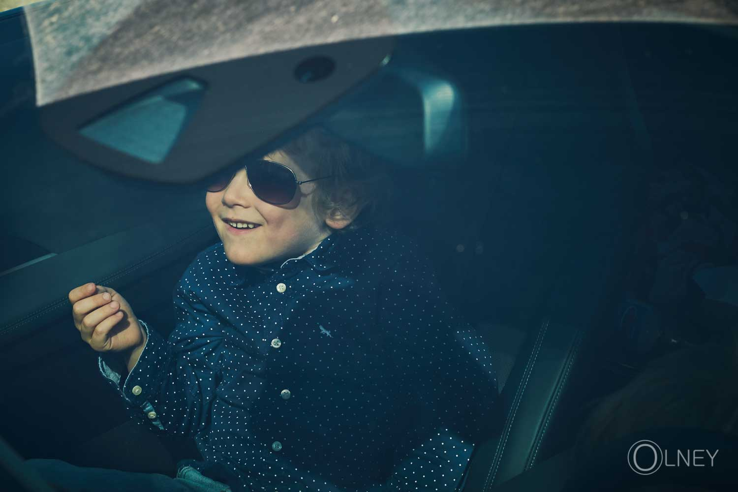 I'm a star kid in car wearing sunglasses