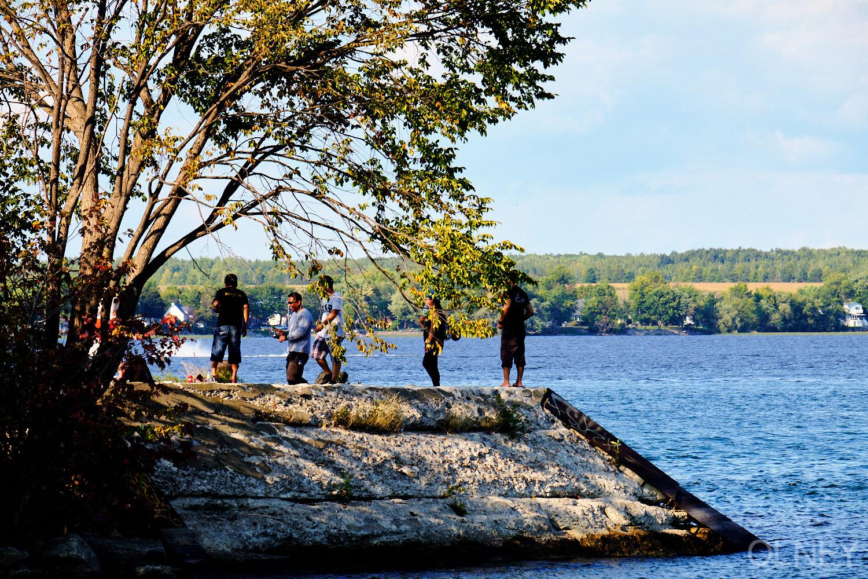 men fishing on lac st-louis