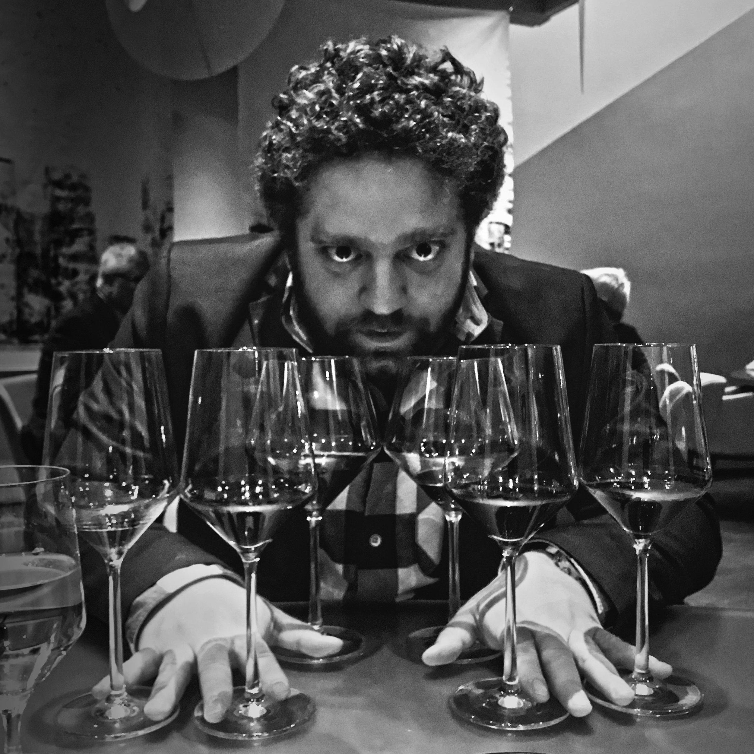Lex faces off against six glasses of grape juice.