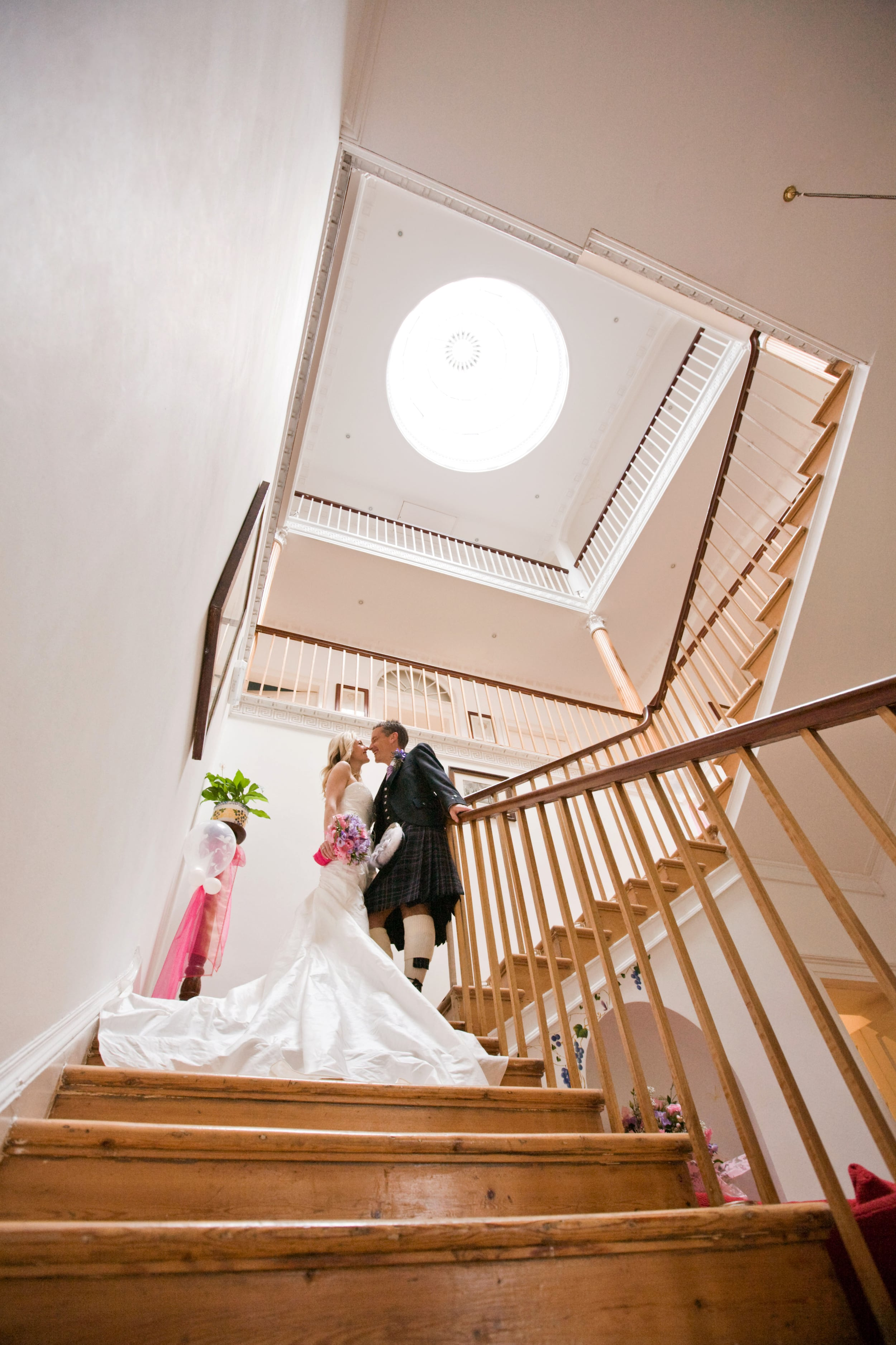 03 Bride and groom on stairs (Marion).jpg