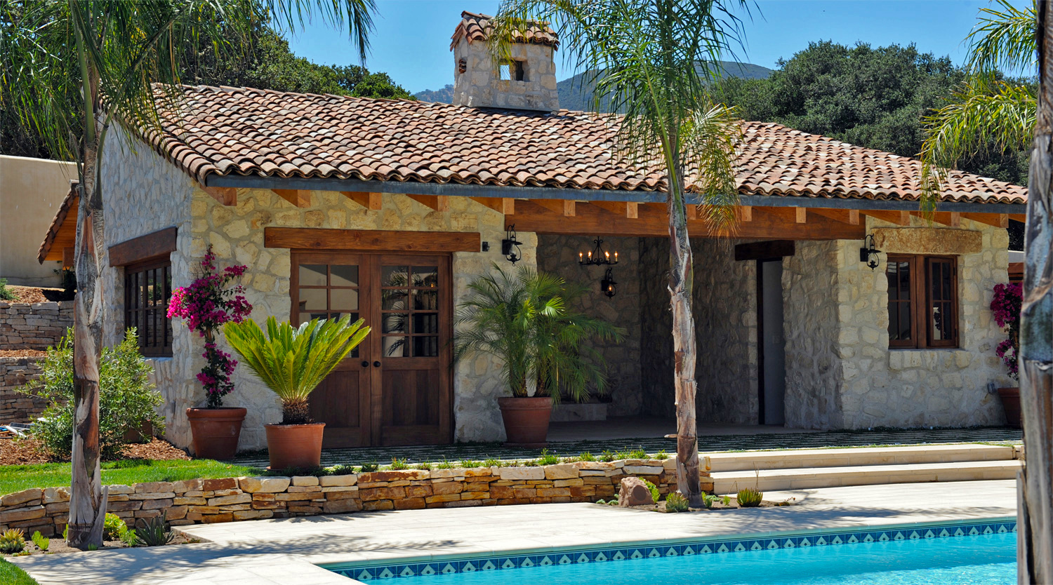 Inspired by centuries old Tuscan farmhouses in Italy. Pool Pavilion,Swimming Pool, and surrounding landscaping.  Building Design & Construction, Landscaping Design & Installation.