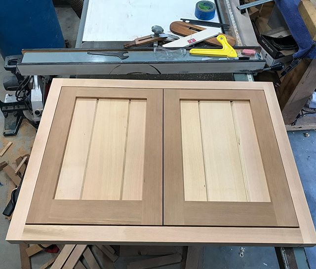 Set of doors being made for in a stucco and stone BBQ counter