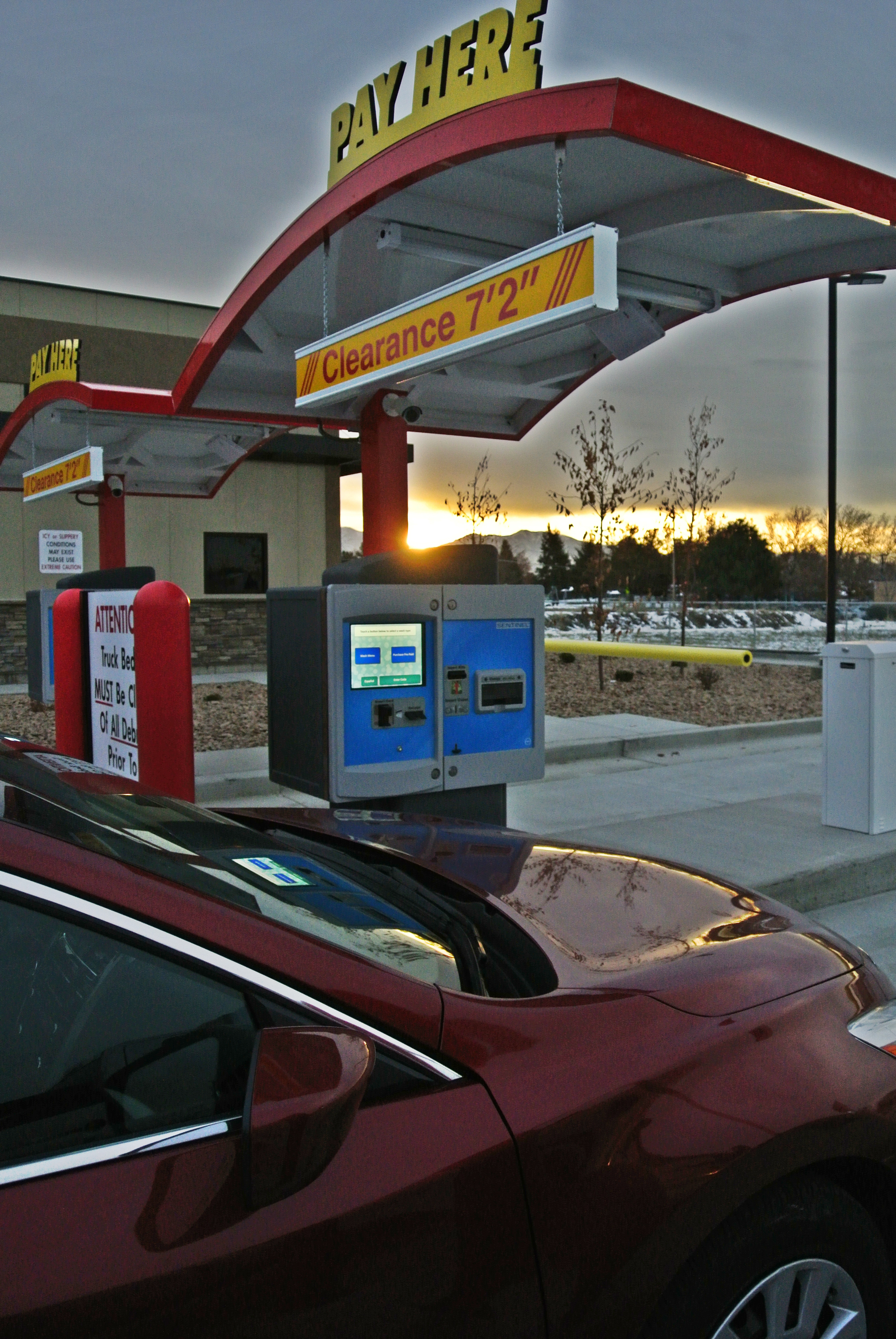 Two Unitec Sentinel pay stations at sunrise
