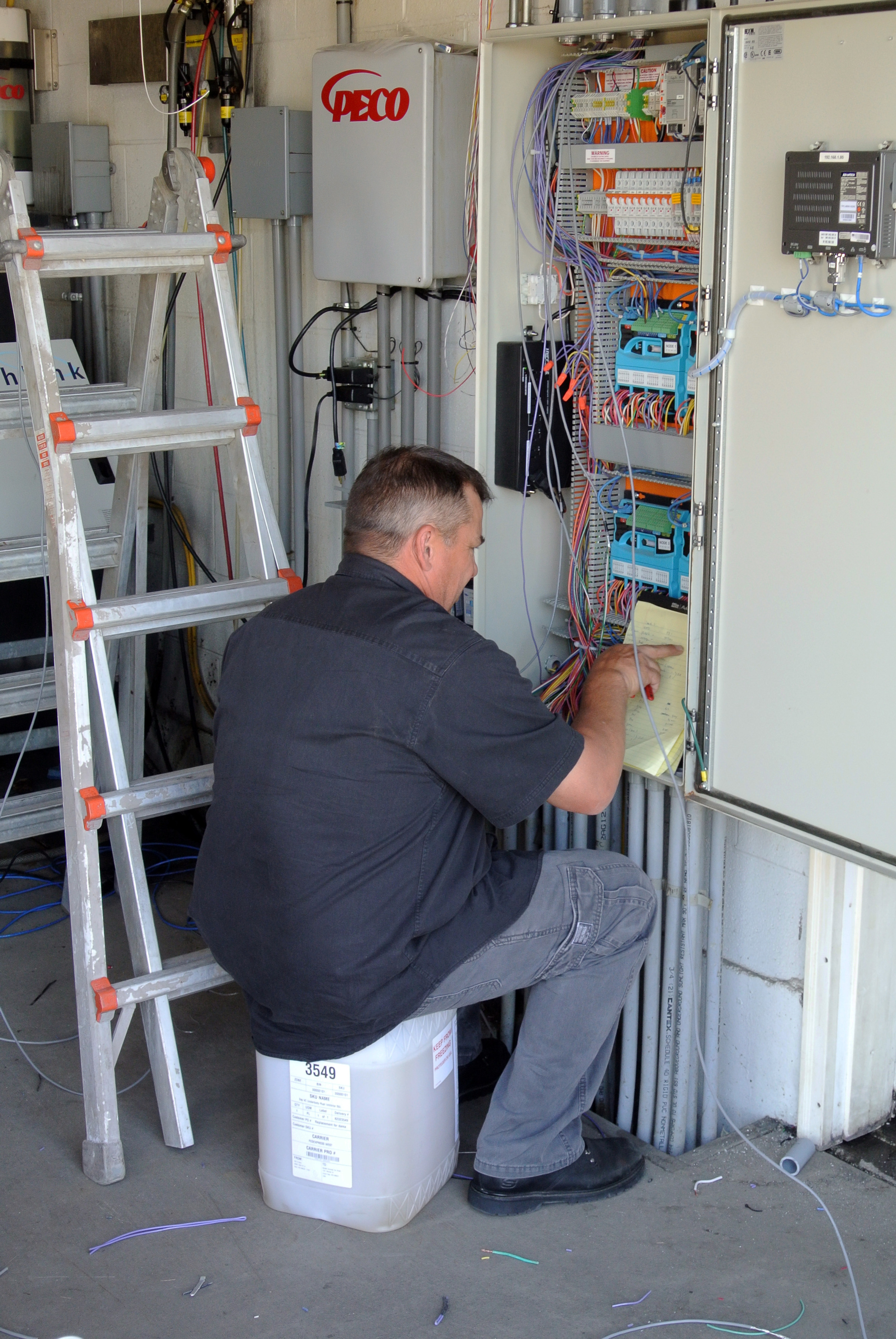 Mike Jensen custom wires a Washlink gate controller to Splash's RTC and Unitec Pay Stations.