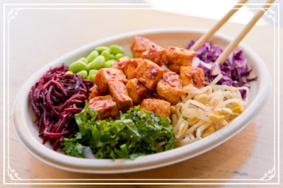 Spicy Salmon BeBowl with Pickled Beets, Edamame, Red Cabbage, Bean Sprouts, and Kale Salad.