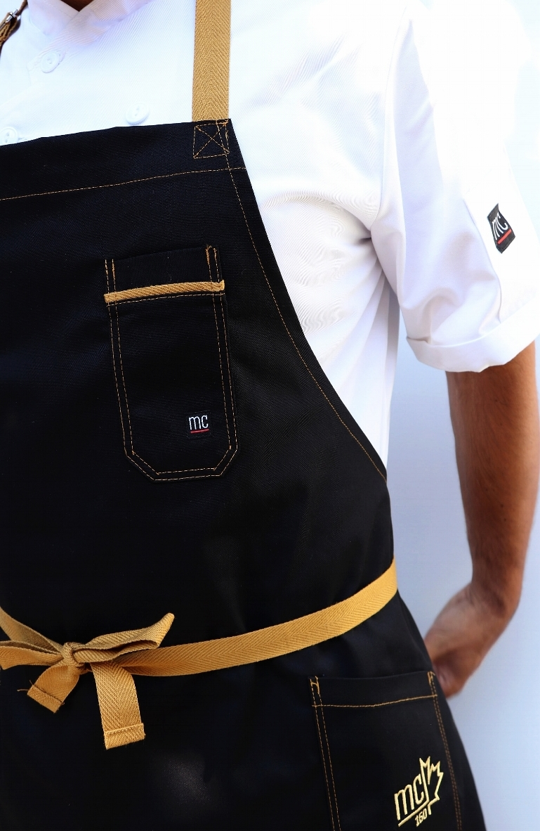 Pictured: XXI Chophouse Custom Apron. CANADA 150 Inspired with gold accents.