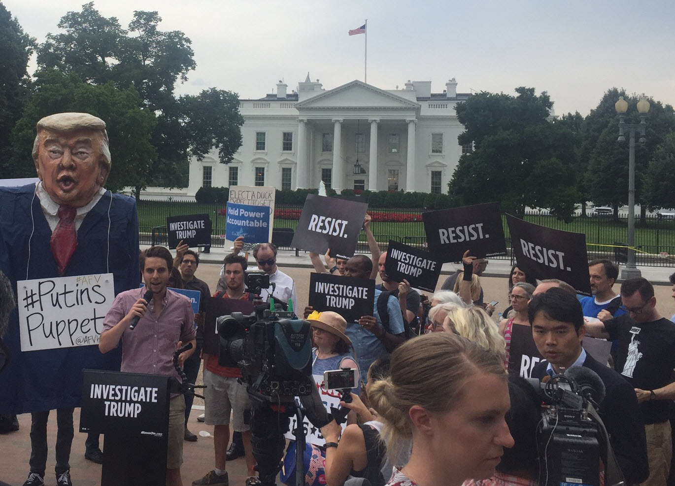 A protest outside of the White House following news that Donald Trump Jr. sought to collude with a Russian agent to undermine a political opponent.