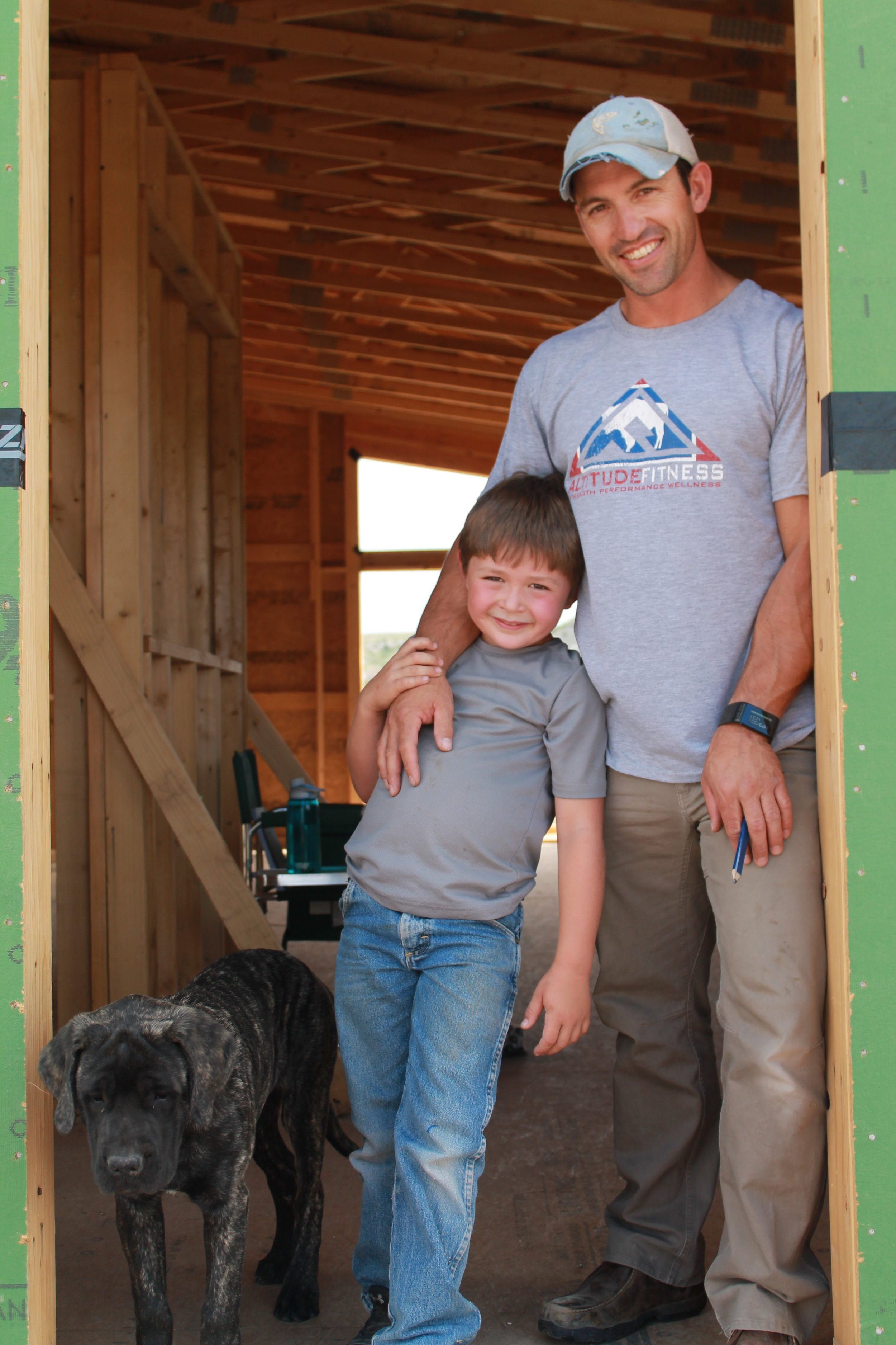 Cory Toye, his son Joe, and their dog Clementine (Tiny) on the Crowheart site.
